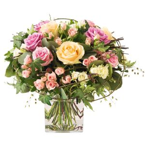 romantic hand tied bouquet of pink and peach roses with greeney
